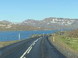 Drive_to_Seydisfjordur_015_iPhone_08092021 - Driving the pass between Egilsstadir and Seydisfjordur under cloudless skies, which gave us hope that just maybe Seydisfjordur might have great weather