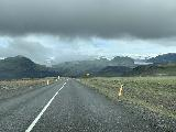 Drive_to_Solheimajokull_001_iPhone_08072021 - Approaching Solheimajokull where the dark clouds make it seem like it wouldn't be such a great visit given the conditions