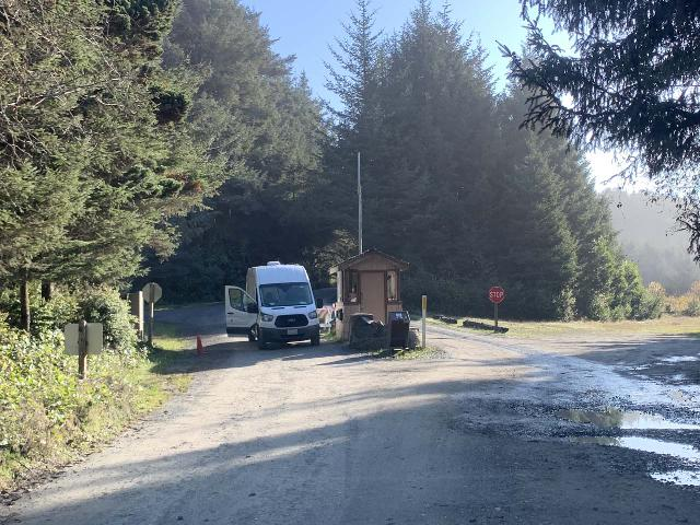 Drive_to_Trillium_Falls_007_iPhone_11212020 - Looking back at the entrance kiosk to the Prairie Creek Redwoods State Park along Davidson Road