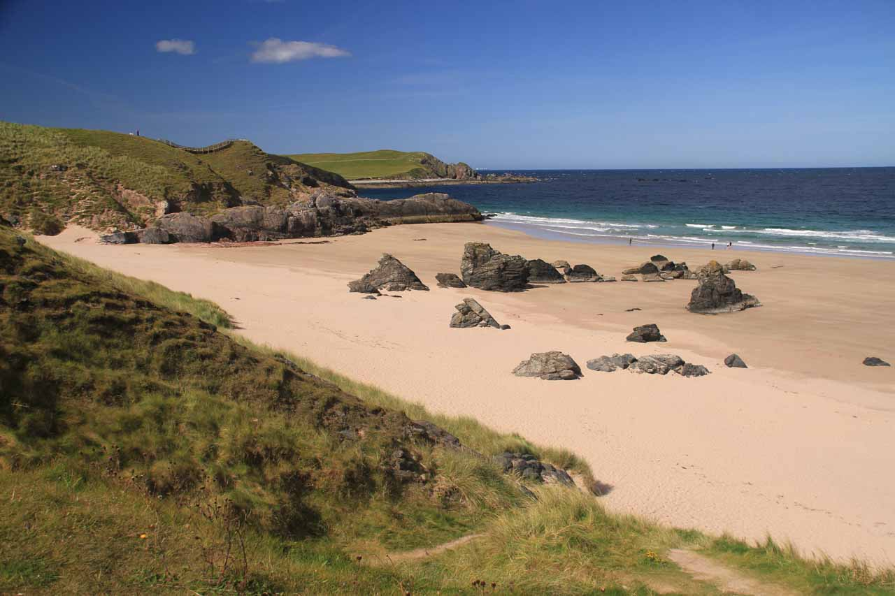 Less than a mile from the Smoo Cave was the award winning beach at the visitor center at Durness, which featured intriguing rocks as well as nice soft sand that Tahia loved to play in