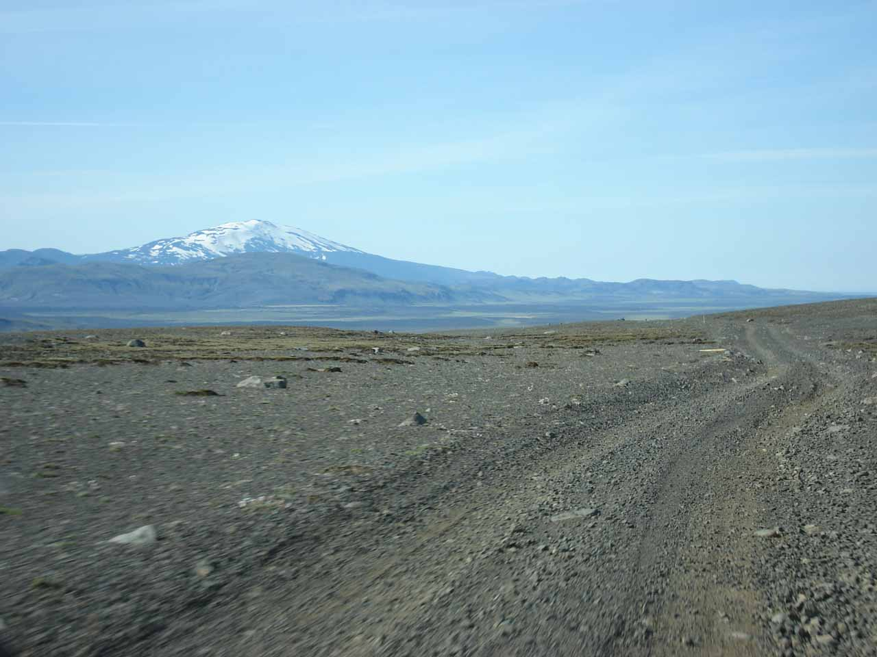 On the black dirt road with Mt Hekla in the distance