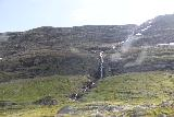 E134_Rv9_013_07242019 - Looking towards some waterfall while driving on the E134 through the southern part of the Hardangervidda Plateau