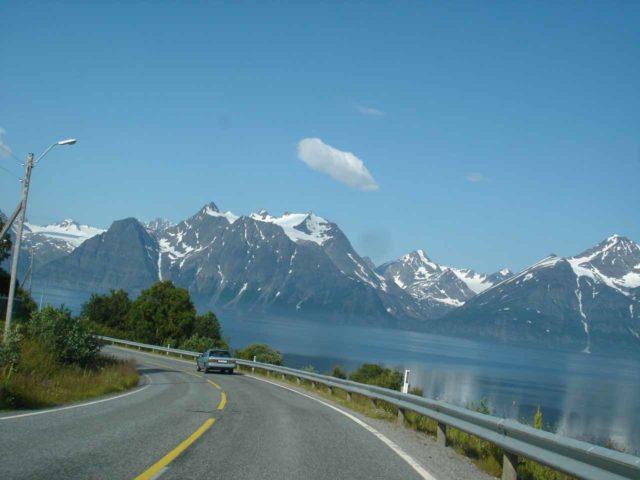 E6_080_jx_07082005 - Driving south along the E6 where the Lyngen Alps can be seen across the Lyngen Channel