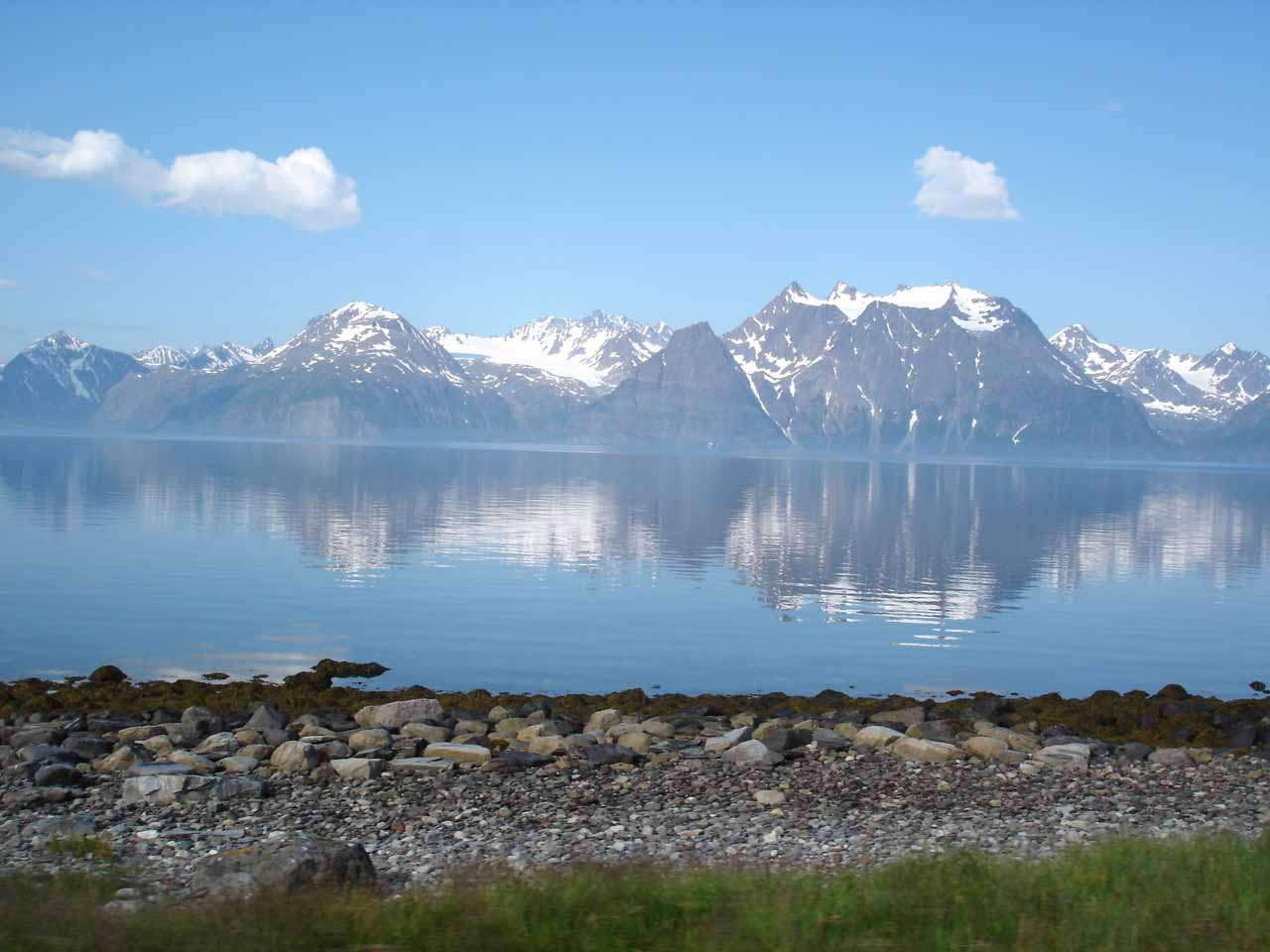 After visiting Målselvfossen, we continued going north on the E6 when we started to see the impressive Lyngen Alps across the channel alongside the road