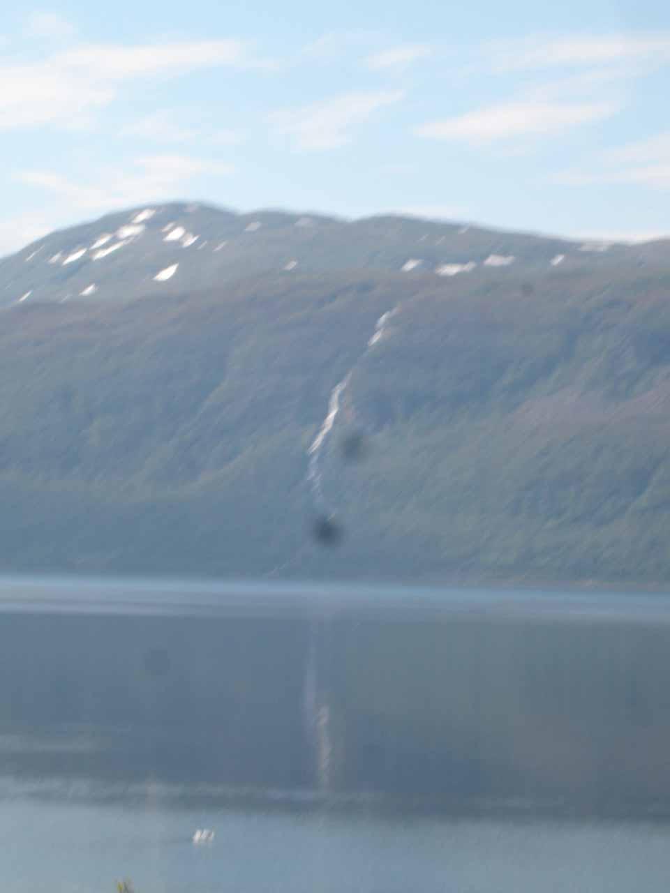 This blurry photo of the first waterfall we noticed across Kåfjorden might be on Bjørkelva (Bjørkelvfossen?)