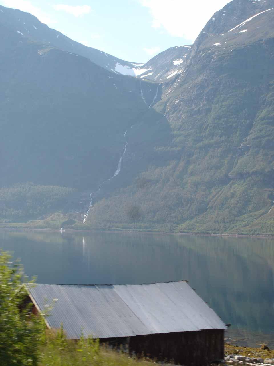 Looking over this tin-roofed house along Kåfjorden towards this waterfall I believe is on the Båelva (Båfossen?)