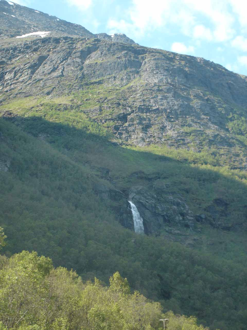 Around the time we were either leaving or had already left Kåfjorden, Julie got this partial view of some other waterfall whose stream we can't pinpoint