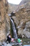Eaton_Canyon_086_02042012 - Contextual view of the Eaton Canyon Falls with some people chilling by the plunge pool and one daredevil who made his way underneath the boulder wedged above the waterfall during our February 2012 visit