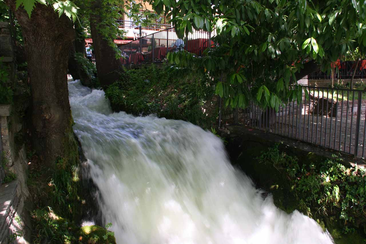 Part of the Edessa Waterfalls passing besides a cafe (or taverna)