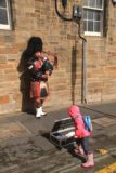 Edinburgh_097_08212014 - Tahia feeding a bagpipe playing busker in Edinburgh