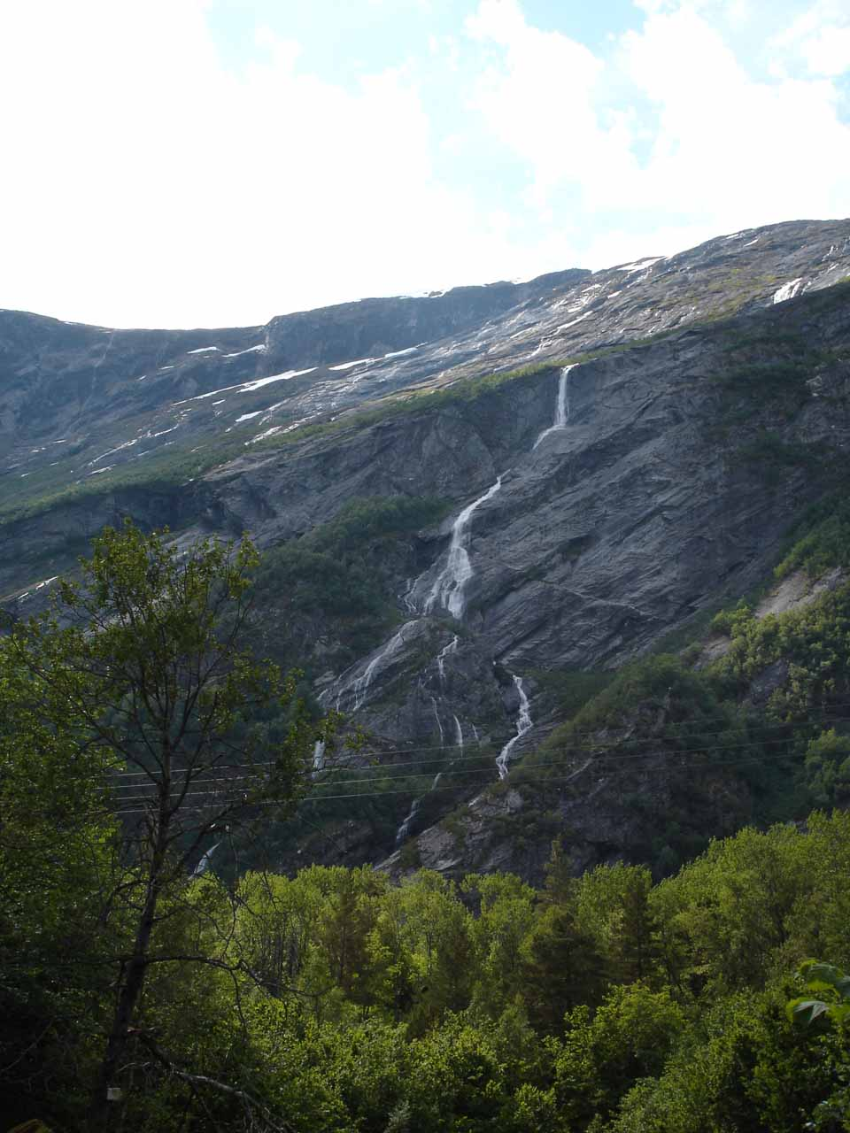This tall but thin waterfall in Eikesdalen was the first one we saw when we left Mardalsfossen.  I believe it was on either the Sandgrova watercourse or Bruåa watercourse.  So I guess it could be called Sandgrovafossen or Bruåafossen, depending on which watercourse it belonged to