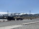 Ely_002_iPhone_04012021 - Looking towards the snow-covered mountains on the south side of Ely as we were pulling out of Rolberto's and continuing our long drive to Twin Falls