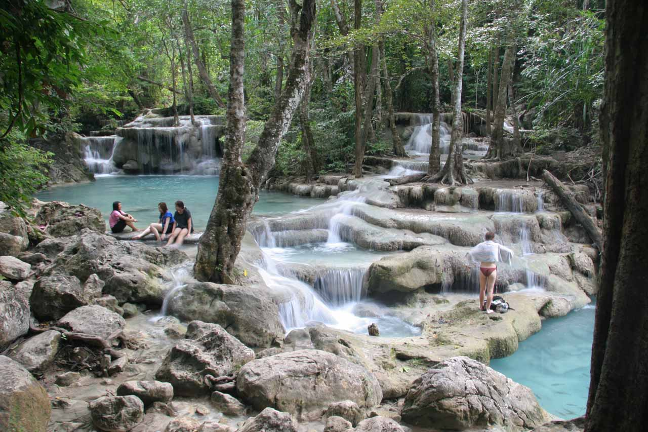 The fifth Erawan Waterfall with a handful of people enjoying the travertine pools here