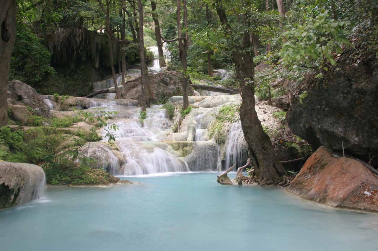 The cascading sixth Erawan Waterfall with its wide plunge pool
