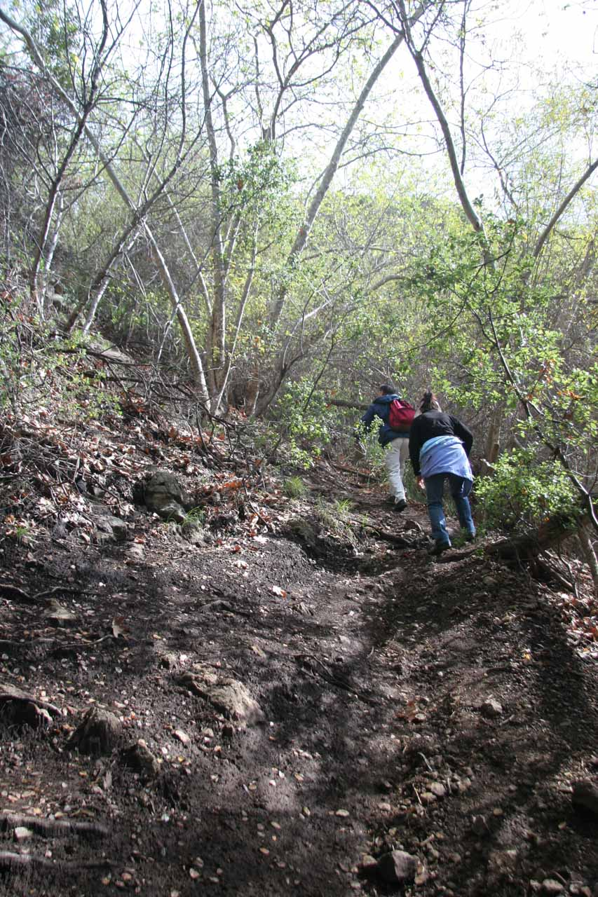 A pair of people making the steep climb up towards the upper Escondido Falls
