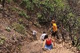 Escondido_Falls_169_04072019 - People descending on the eroded gully after having attempted to go up to the Upper Escondido Falls in April 2019