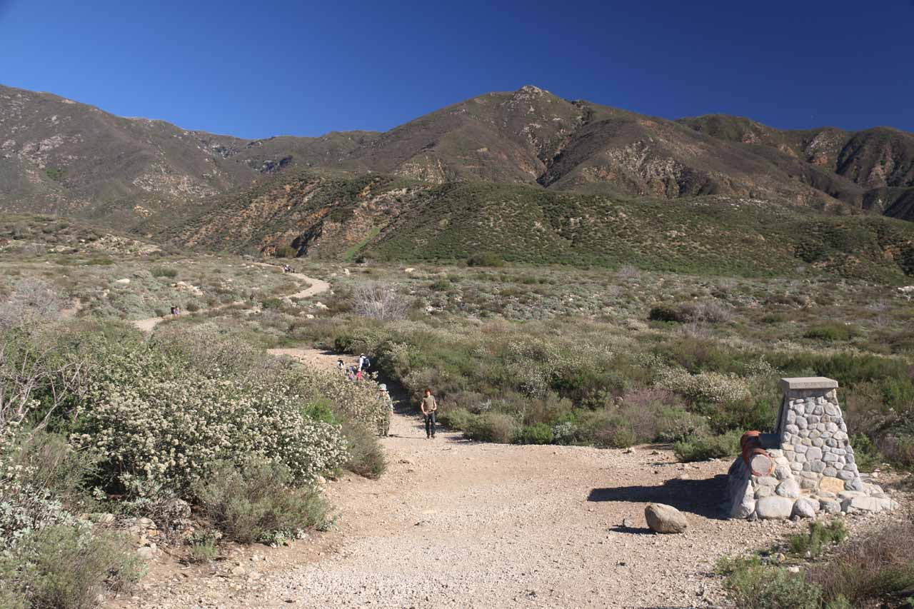 Looking ahead at the open and exposed trail to Etiwanda Falls backed by foothills of the San Bernardino Mountains