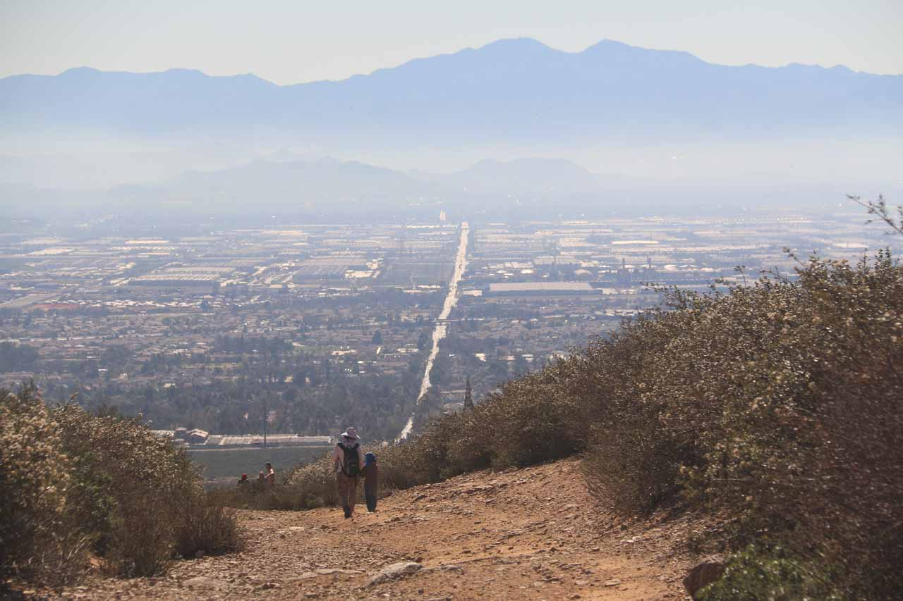 Another look at the dramatic context of the downhill trail with the smoggy Inland Empire in the distance