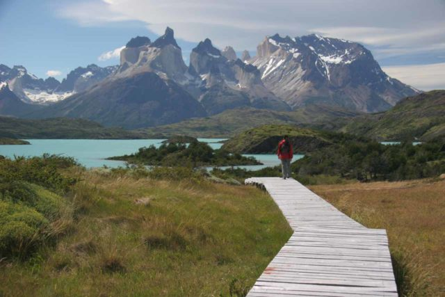 Explora_en_Patagonia_011_12242007 - Julie on the boardwalk soaking in the tremendous panoramas of the Curenos del Paine and Lago Pehoe as we were done checking out Salto Chico