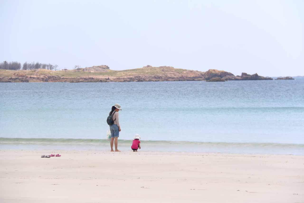 Julie and Tahia enjoying themselves at the beach at Ezaro