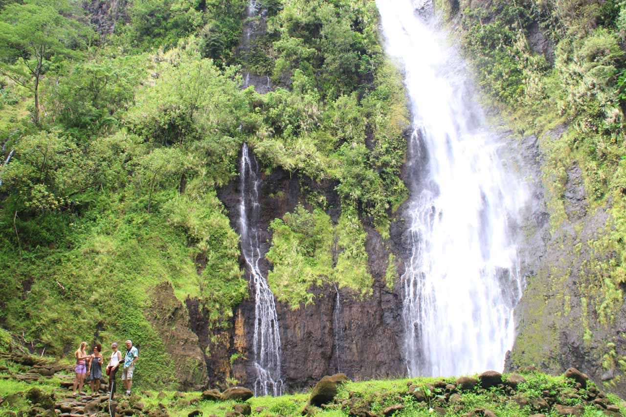 A group of Americans enjoying Vaimahutu Falls while providing a sense of scale