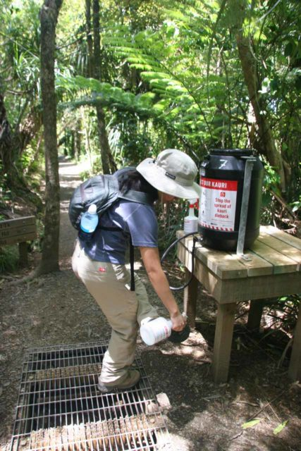 Fairy_Falls_004_01092010 - Julie trying to do her part to fight off the Kauri Dieback Disease before hiking on the Fairy Falls Track