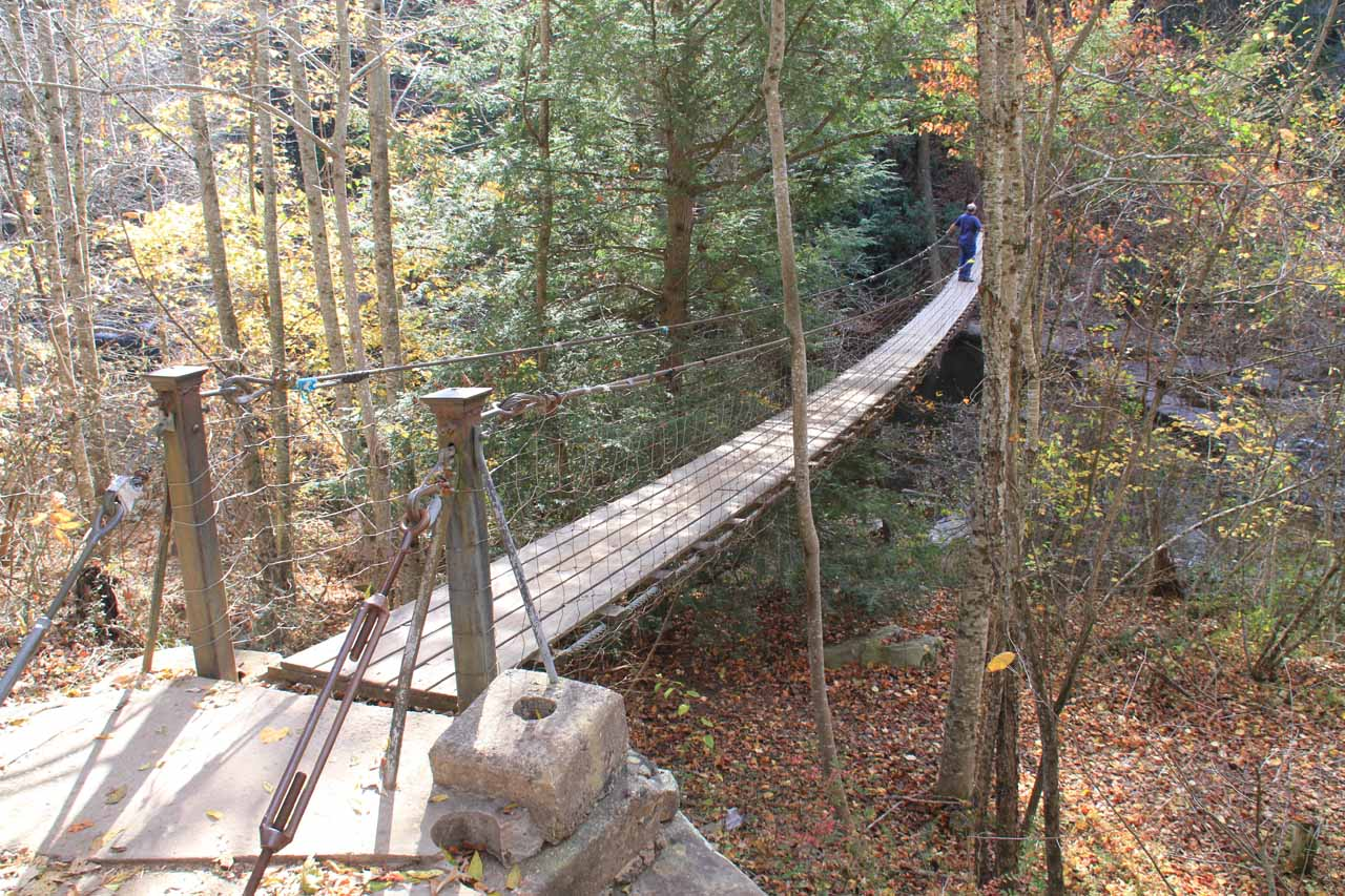 Crossing the suspension bridge above Cane Creek Cascade