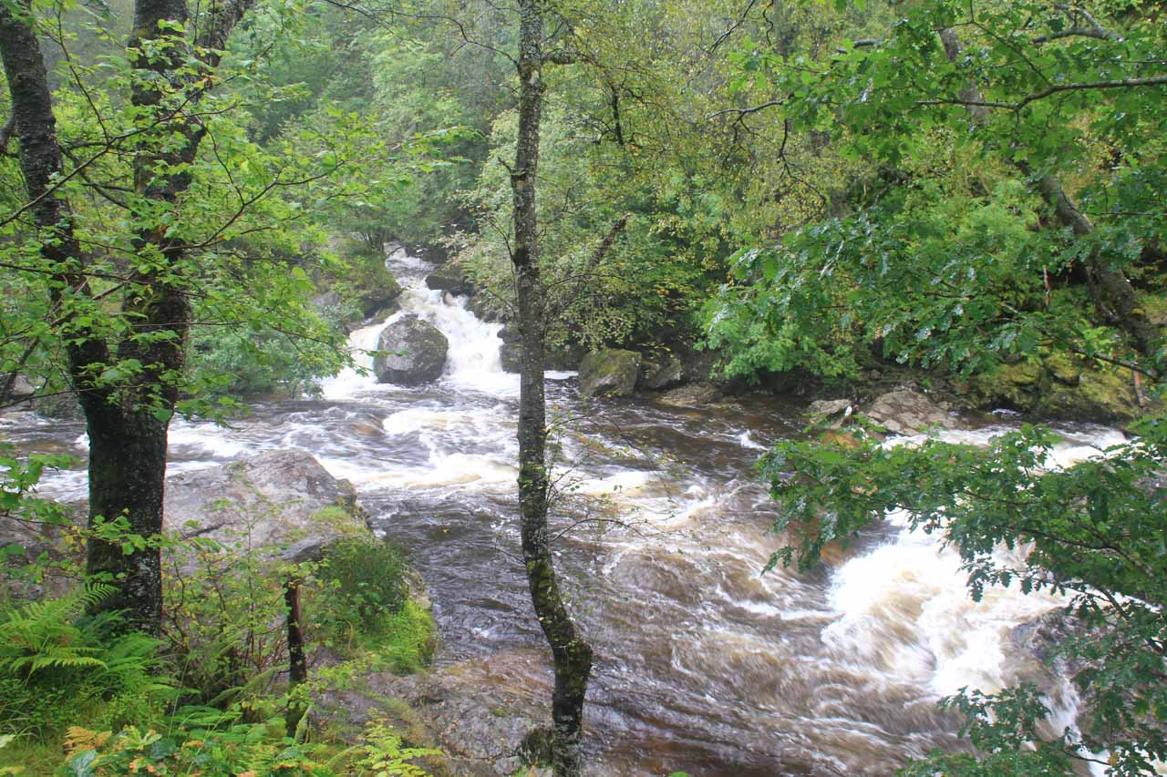 Looking across the raging River Falloch towards another cascade feeding it
