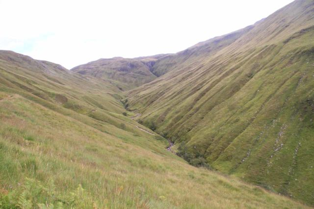 Falls_of_Glomach_068_08242014 - Hiking up the side valley carved forth by the Allt an Leoid Ghaineamhaich Stream flanked by wrinkles in the valley walls resulting from gullies draining ephemeral streams and cutting into the valley even more