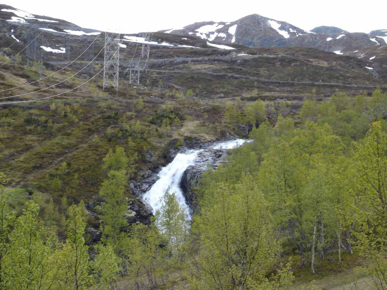 This gushing waterfall beneath the power lines might be what Norgesglasset called Brekkefossen
