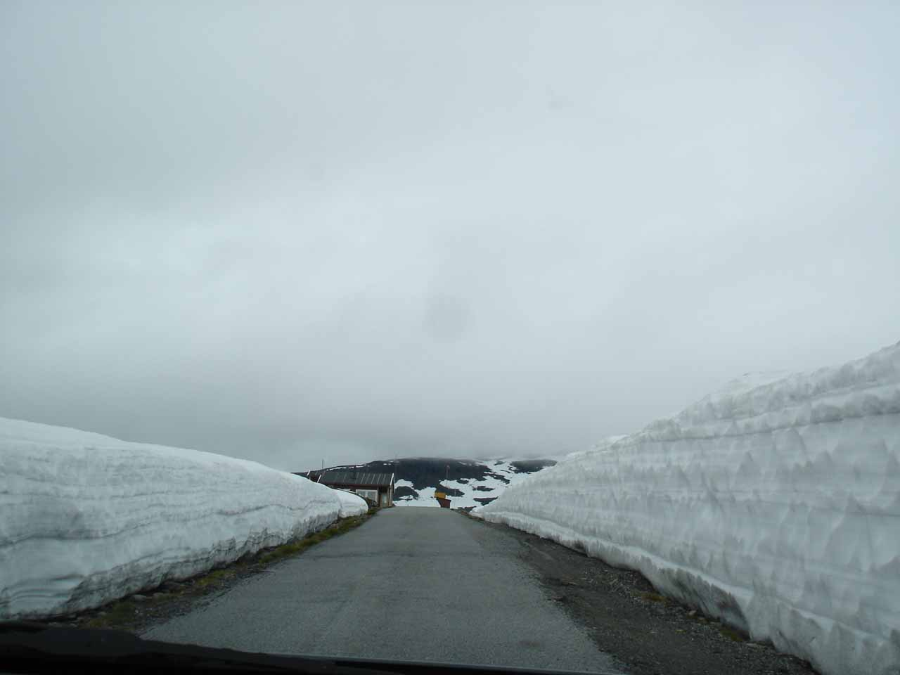 Driving between a short wall of snow while the clouds seemed to be very low overhead
