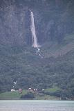 Feigefossen_022_07202019 - Zoomed in context of Feigefossen spilling over some farms before it as seen from across Lustrafjorden