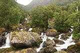 Feigefossen_054_07202019 - Wide segmented waterfalls on the Feigeelvi beneath some power lines for the farm nearby Feigefossen