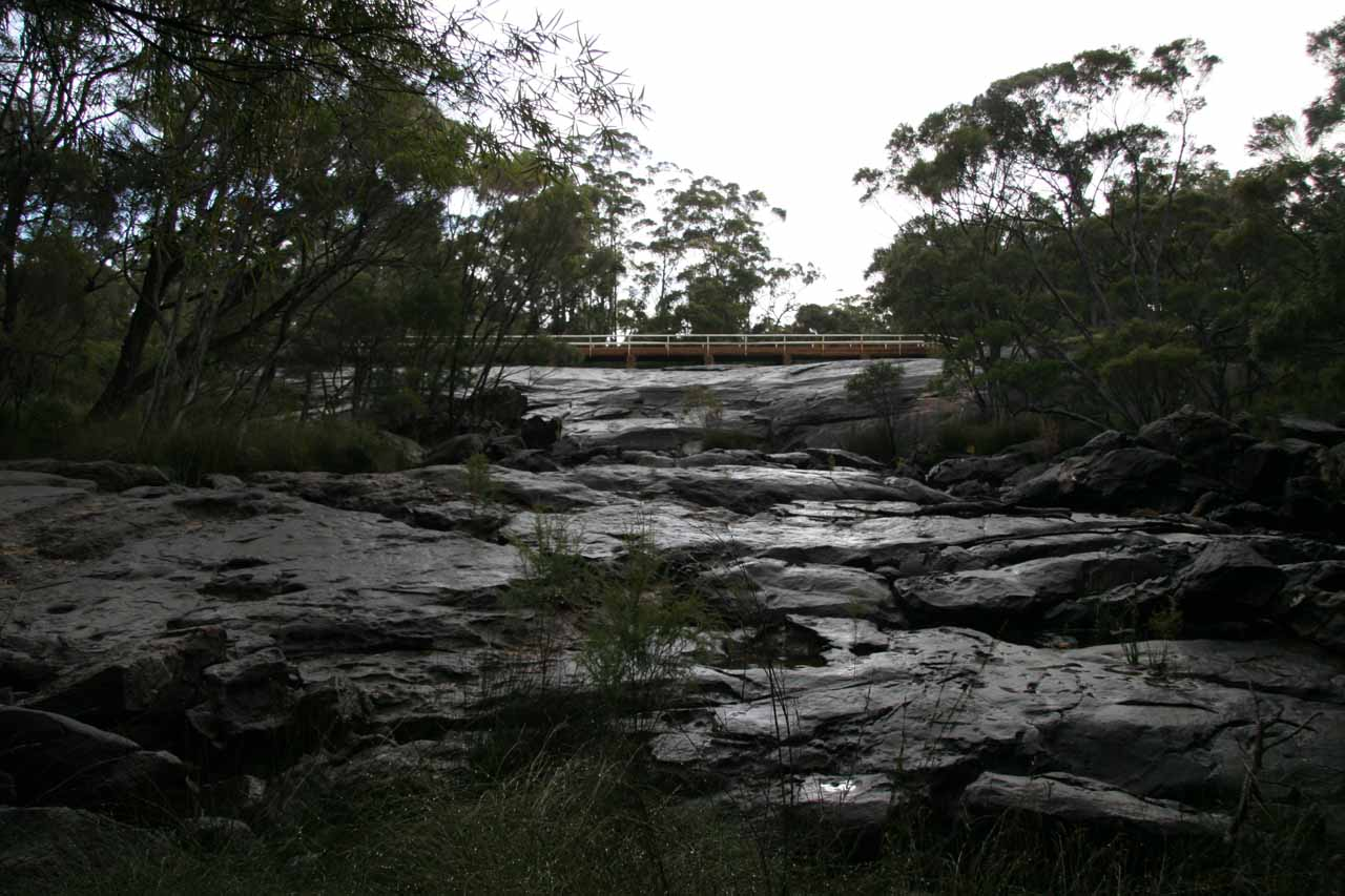 Looking up at Fernhook Falls (or what's left of it) with the road bridge providing a sense of how wide this waterfall could have been