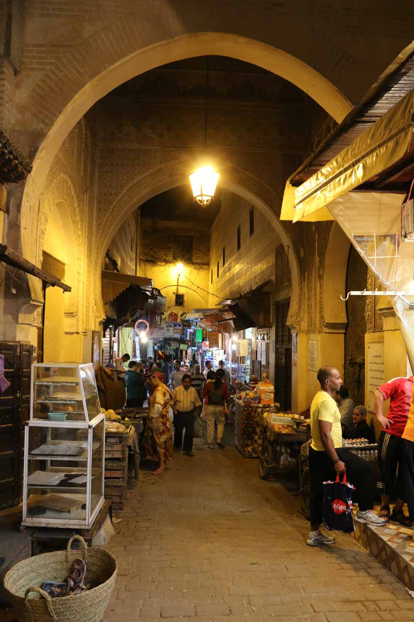 Walking beneath consecutive adorned archways in the Fes medina