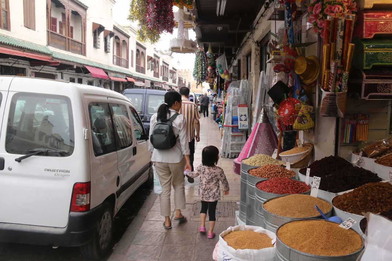 Julie and Tahia walking past some spices being sold in the Jewish Quarter of Fes