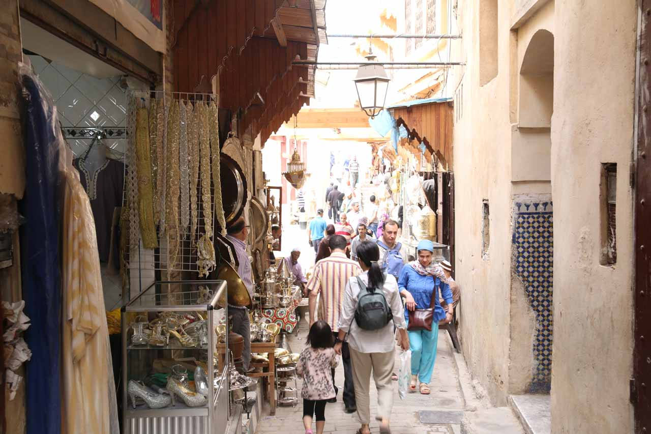 Now Julie and Tahia passing through an area of the souks where they were selling carpets and expensive trinkets