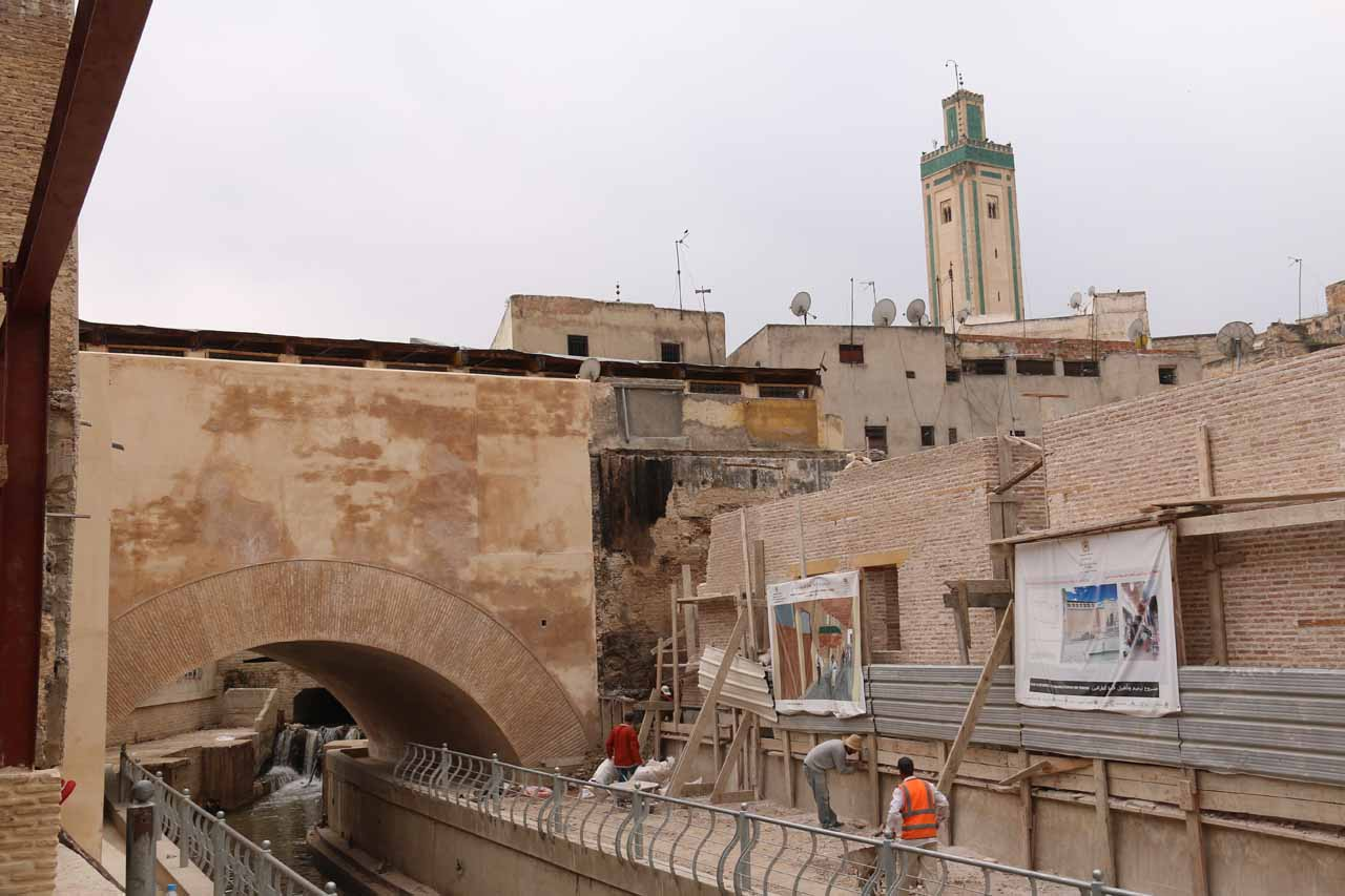 Looking back towards a mosque above the mostly hidden river passing through Fes