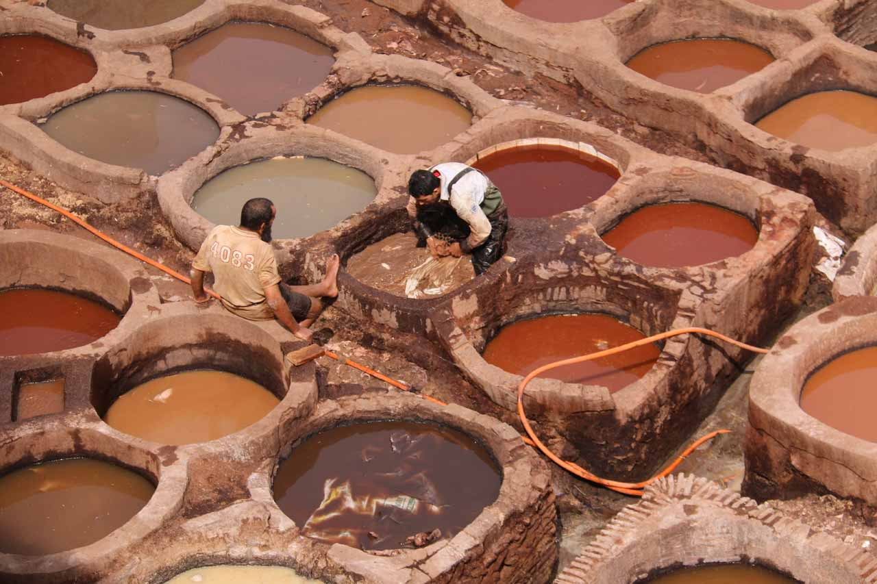 Closer look at some of the workers within the vats of dyes, whose fumes I'm sure can't be good to be breathing every day
