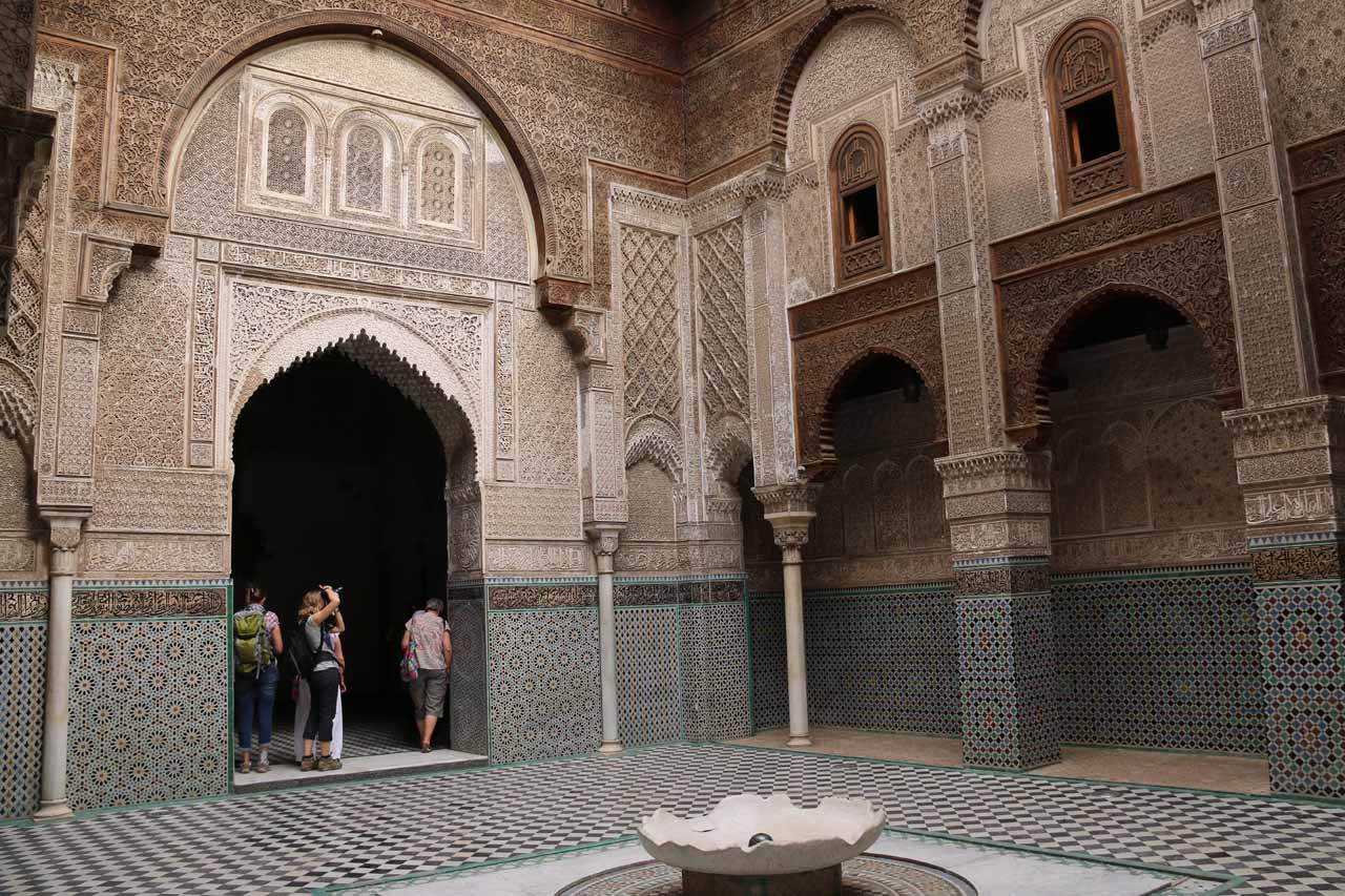 At the ornate courtyard of the Attarine Medersa