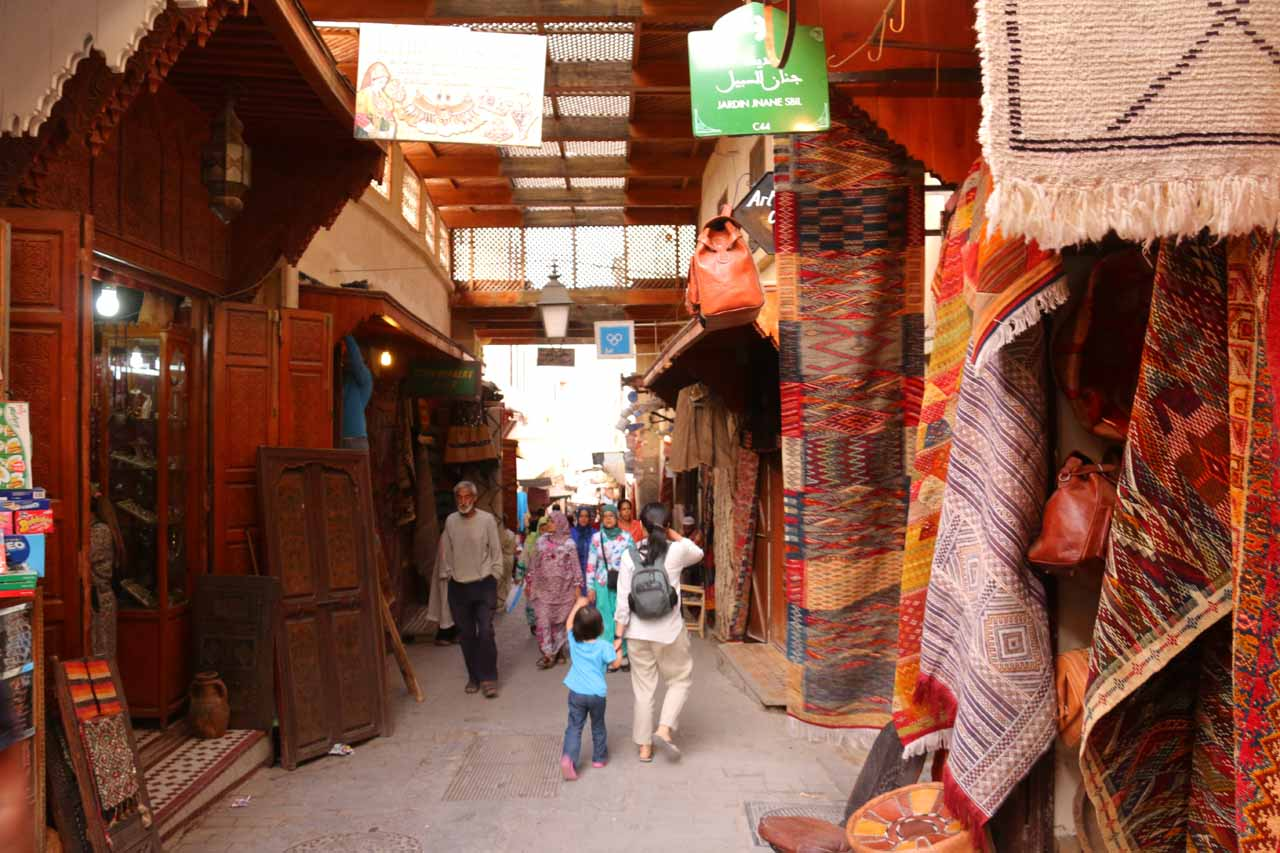 Passing through a souk full of carpets on the way to Souk el Henna