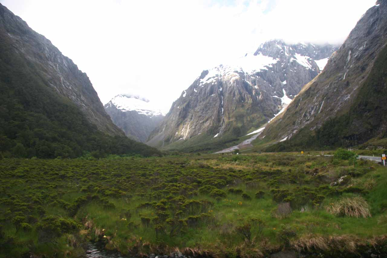 Finally the weather started to clear and we started to see some of the peaks of the surrounding mountains along the Milford Sound Highway