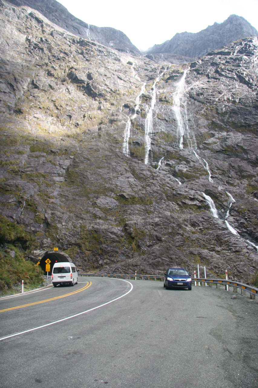 Another look at the west end of the Homer Tunnel flanked by waterfalls tumbling around it