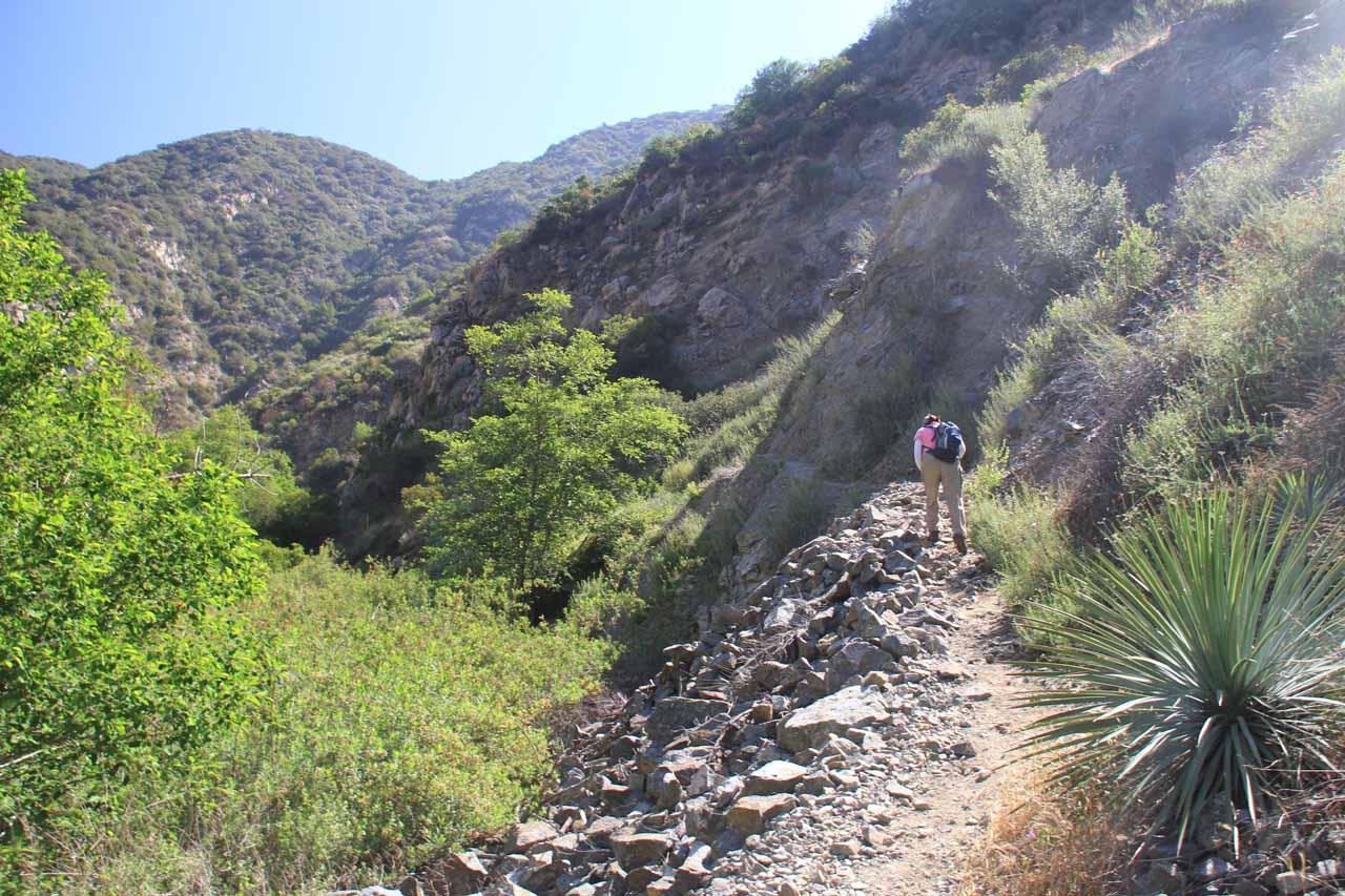 Mom going up a narrow part of the trail soon after crossing Fish Creek