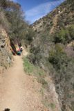 Fish_Canyon_Falls_042_02132016 - Julie and Tahia negotiating some of the narrowness of the Fish Canyon Falls Trail with some mild dropoff exposure in February 2016