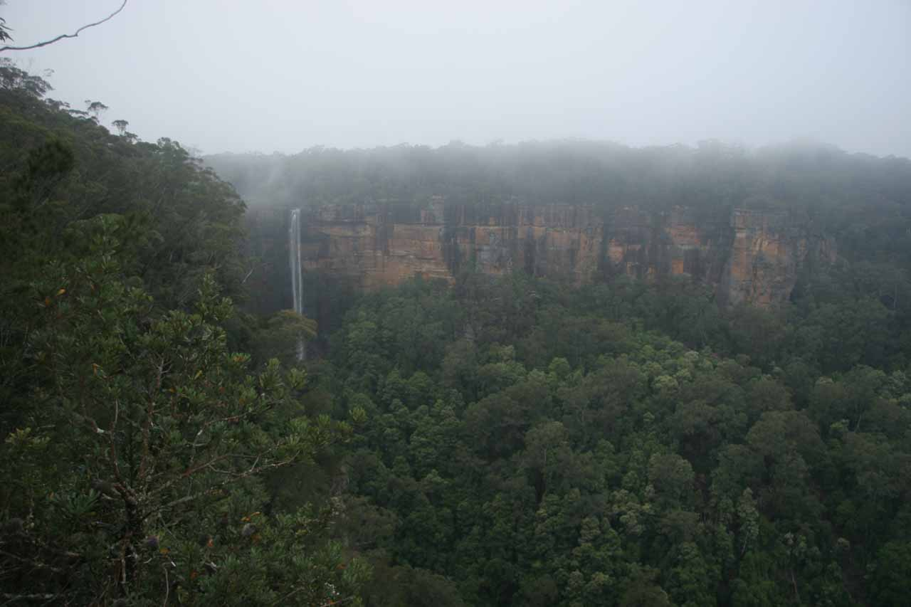 Distant view of the Fitzroy Falls in the rain from I think Richardon's Lookout