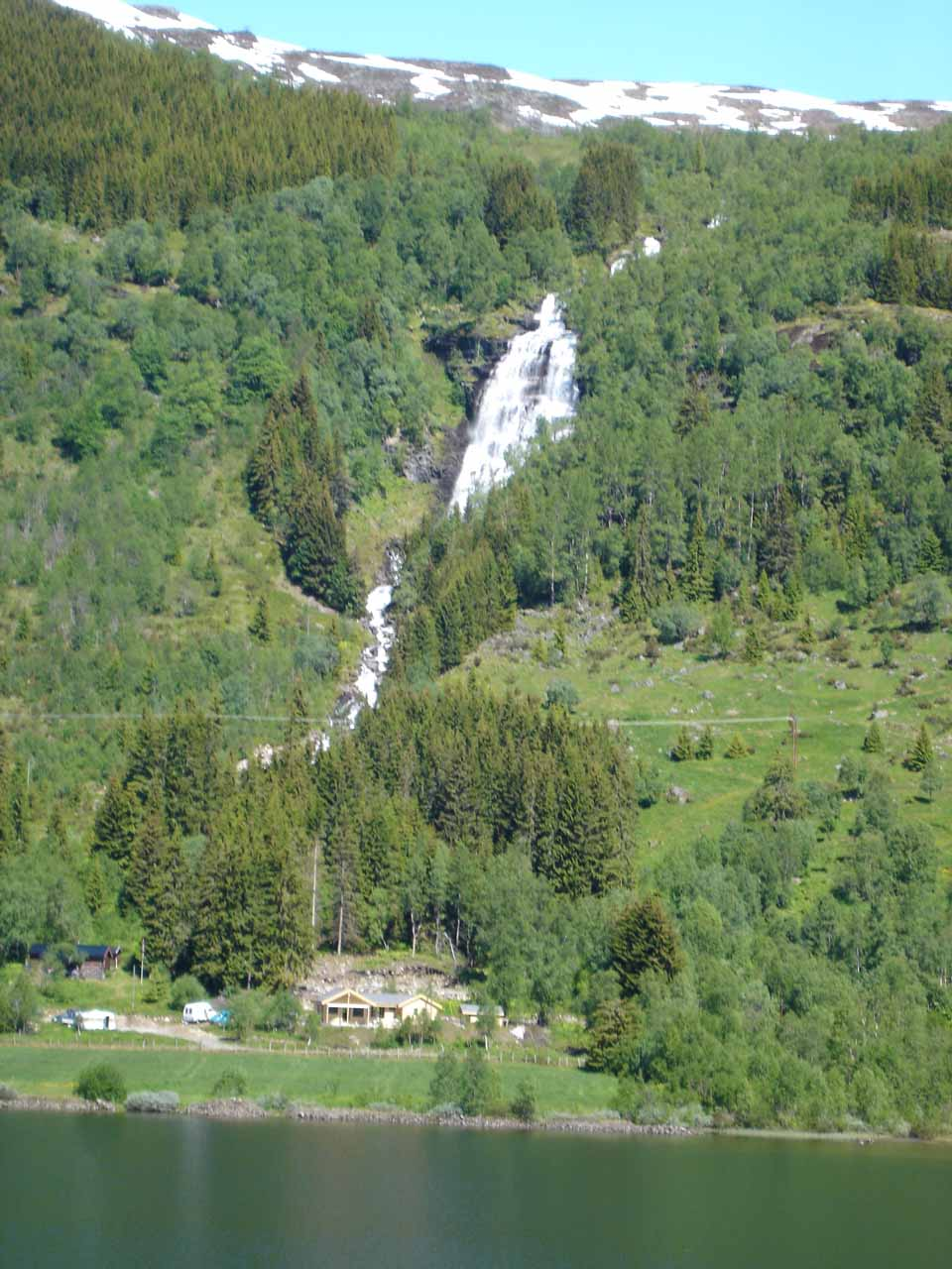 Probably around 15 minutes into our drive on the Rv5 from Sogndalsfjøra, Julie spotted Svedalsfossen across Dalavatnet