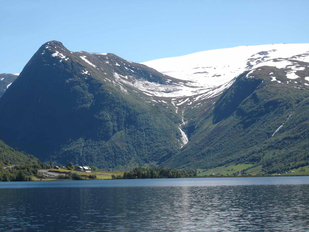 As we were done touring Waterfall Country, we then continued northwards towards Nordfjord, but that wasn't before we saw this surprise waterfall called Vikafossen behind the lake Jølstravatnet