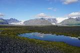 Fjallsarlon_207_08082021 - Looking back across a small pond towards the familiar glacier arms of Skaftafellsjokull and Svinafellsjokull as we were driving back in search of Morsarfoss