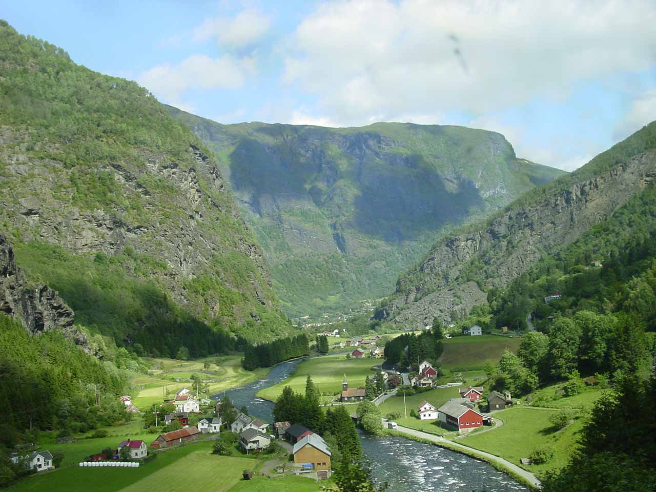 Colorful farms and homes decorating the scenic Flåmsdalen Valley. We managed to get such views while riding the Flam Railway